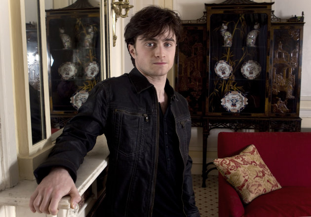 "FILE - In this Nov. 12, 2010 file photo, British actor Daniel Radcliffe poses for photographs following an interview with the Associated Press to discuss his role in Harry Potter and the Deathly Hallows Part 1. The time is coming - maybe sooner than you expect - when you look at Daniel Radcliffe and don't think ""Harry Potter."" The 23-year-old actor has gone from boy wizard to Broadway hoofer to Beat poet Allen Ginsberg, whom he plays in new film ""Kill Your Darlings."" (AP Photo/Joel Ryan, File)"