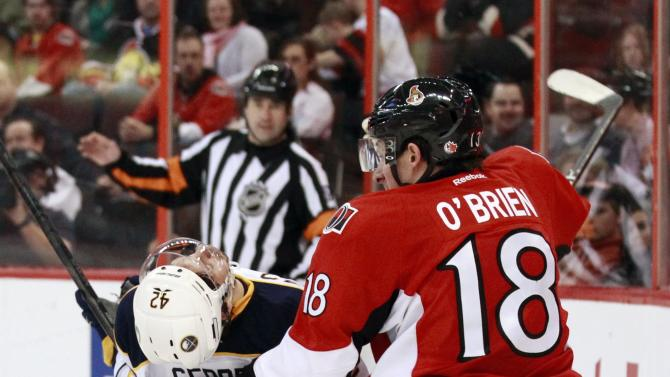 Ottawa Senators' O'Brien gets tangled up with Buffalo Sabres' Gerbe during the third period of their NHL hockey game in Ottawa