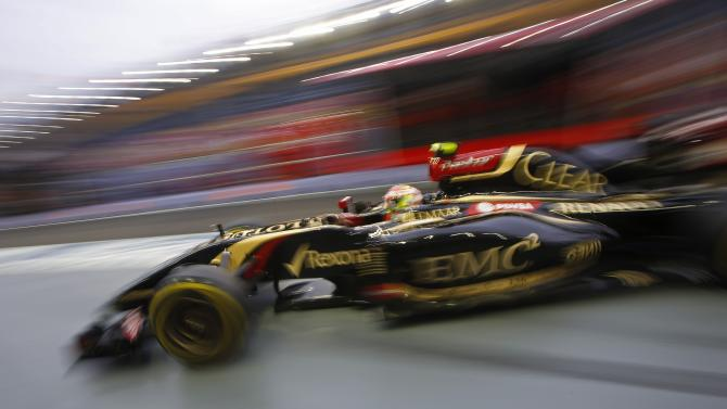 Maldonado pulls in for a pit stop during the third practice session of the Singapore F1 Grand Prix at the Marina Bay street circuit in Singapore
