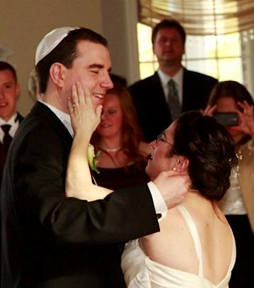 In this April 7, 2103 photo provided by Bruce Presner, Hava Samuels strokes the cheek of her new husband, Paul Farziano, as they dance on their wedding day at East Wind in Wading River, NY. Samuels and Forziano, who are mentally disabled, say the group homes where they live are blocking their request to live together as husband and wife, so are suing for the right to do so. (AP Photo/Bruce Presner)