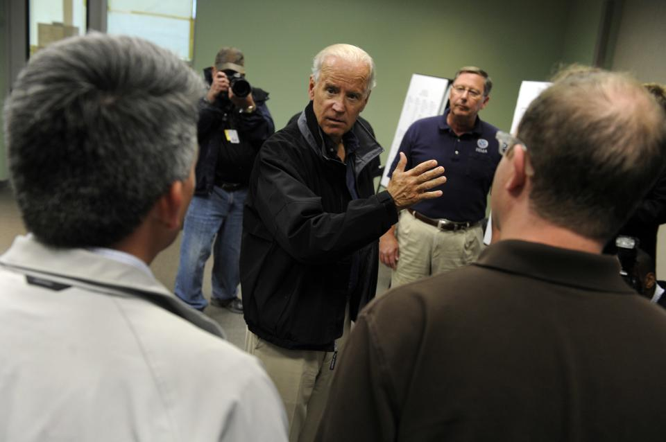 After flying in a helicopter over areas ravaged by the recent flooding, Vice President Joe Biden, center front, flanked by Colorado elected officials and FEMA workers, speaks Monday, Sept. 23, 2013, at the Disaster Recovery Center in Greeley Colo. (AP Photo/The Denver Post, Kathryn Scott Osler, Pool)