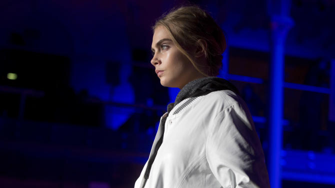 British model Cara Delevingne, Model Of The Year at the 2012 British Fashion Awards, wears a design created by Matthew Williamson during London Fashion Week, at The Royal Opera House in west London, Sunday, Feb. 17, 2013. (Photo by Joel Ryan/Invision/AP)