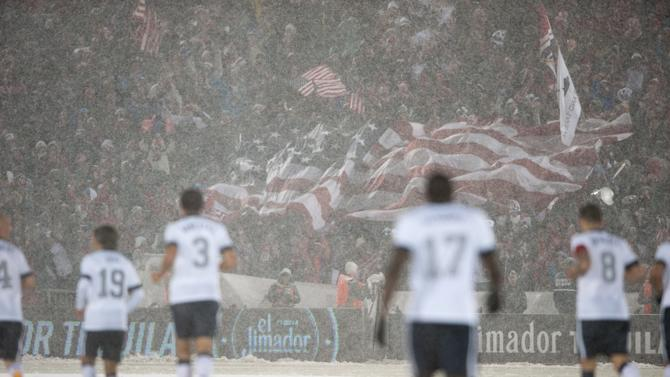 `COMMERCE CITY, CO - MARCH 22: A large United States flag is stretched out by fans to celebrate a goal as United States players return to kickoff position during a FIFA 2014 World Cup Qualifier match between Costa Rica and United States at Dick's Sporting Goods Park on March 22, 2013 in Commerce City, Colorado. (Photo by Dustin Bradford/Getty Images)