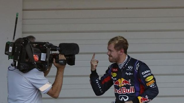 Red Bull Formula One driver Sebastian Vettel of Germany gestures to a camera (Reuters)