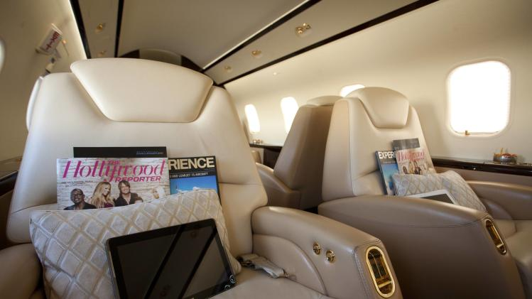 IMAGE DISTRIBUTED FOR BOMBARDIER -  Interior of the Bombardier Challenger 300 is seen at The Hollywood Reporter's Palm Springs Shuttle presented by Bombardier Business Aircraft - Day 1 on Friday, January 4, 2013 in Palm Springs, California.  (Photo by Adam Rose/Invision for Bombardier/AP Images)