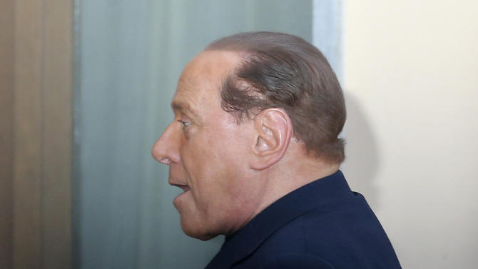 """Former Italian premier Silvio Berlusconi arrives at the """"Sacra Famiglia"""" foundation in Cesano Boscone, near Milan, Italy, to carry out a court order to help the elderly, Friday, May 9, 2014. Berlusconi will help patients with Alzheimer disease for four hours per week as part of his punishment for tax fraud conviction. (AP Photo/Antonio Calanni)"""