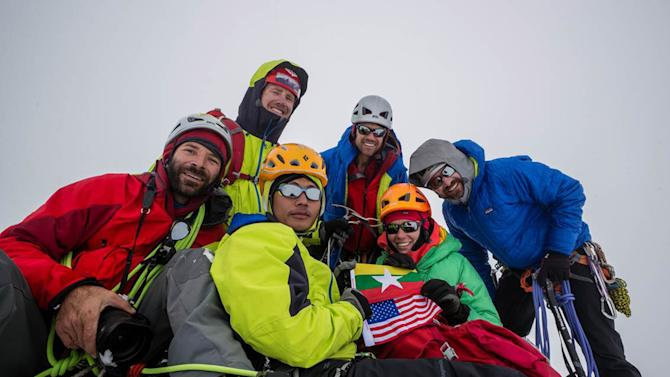 In this photo taken in September 2013, members of a U.S.- Myanmar expedition, from left, Mark Fisher, Eric Daft, Poe Pin, Andy Tyson, Molly Tyson, Chris Nance pose for photos on the peak of Mount Gamlang, in Myanmar. The team believes Mount Gamlang, known as the country's second highest peak, is higher than previously thought, which, if confirmed, could make it the country's highest mountain. (AP Photo/Mark Fisher)