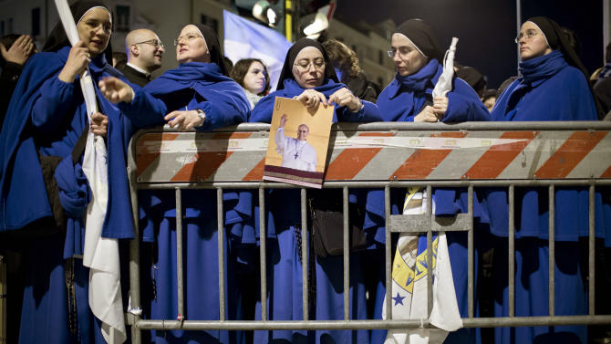 Nuns line up for the inaugural Mass of Pope Francis, at St. Peter's Square at the Vatican, early Tuesday, March 19, 2013. (AP Photo/Oded Balilty)