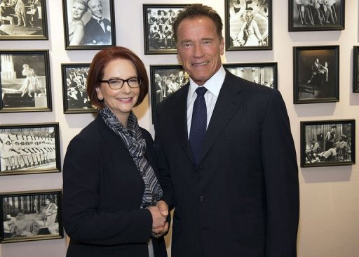 This handout picture released by the Office of the Prime Minister shows Australian Prime Minister Julia Gillard (L) shaking hands with former California governor Arnold Schwarzenegger prior to a meeting at breakfast in Perth on June 13, 2013. Gillard joined forces with Schwarzenegger to urge global action on climate change, saying politics must be put aside
