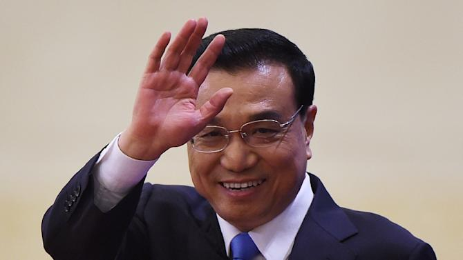 China's Premier Li Keqiang arrives for a press conference after the closing ceremony of the annual session of China's legislature, the National People's Congress, in Beijing's Great Hall of the People, on March 15, 2015