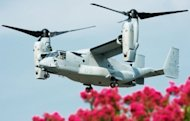 A USMC V-22 Osprey approaches the Pentagon to pick up Japanese Defense Minister Satoshi Morimoto after a press conference at the Pentagon in Washington. The United States said it would delay flights of its Osprey aircraft in Japan until it wins the confidence of its close ally after protests by residents concerned over crashes