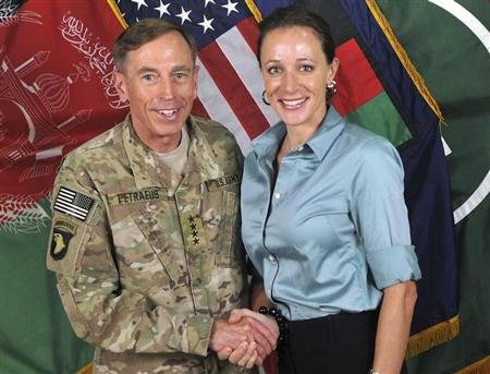 General David Petraeus shakes hands with author Paula Broadwell in this ISAF handout photo originally posted July 13, 2011. REUTERS/ISAF/Handout
