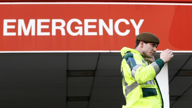 A member of the armed forces walks across the ambulance entrance outside the Accident and Emergency department of St. Thomas' Hospital in central London