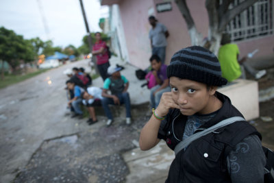 CLICK IMAGE for slideshow: In this June 19, 2014 photo, a 14-year-old Guatemalan girl traveling alone waits for a northbound freight train along with ...
