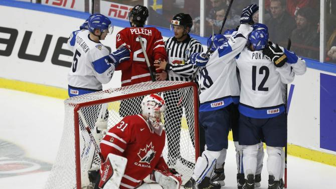 Finland's Lehkonen celebrates his goal on Canada's goalie Fucale during the second period of their IIHF World Junior Championship ice hockey game in Malmo