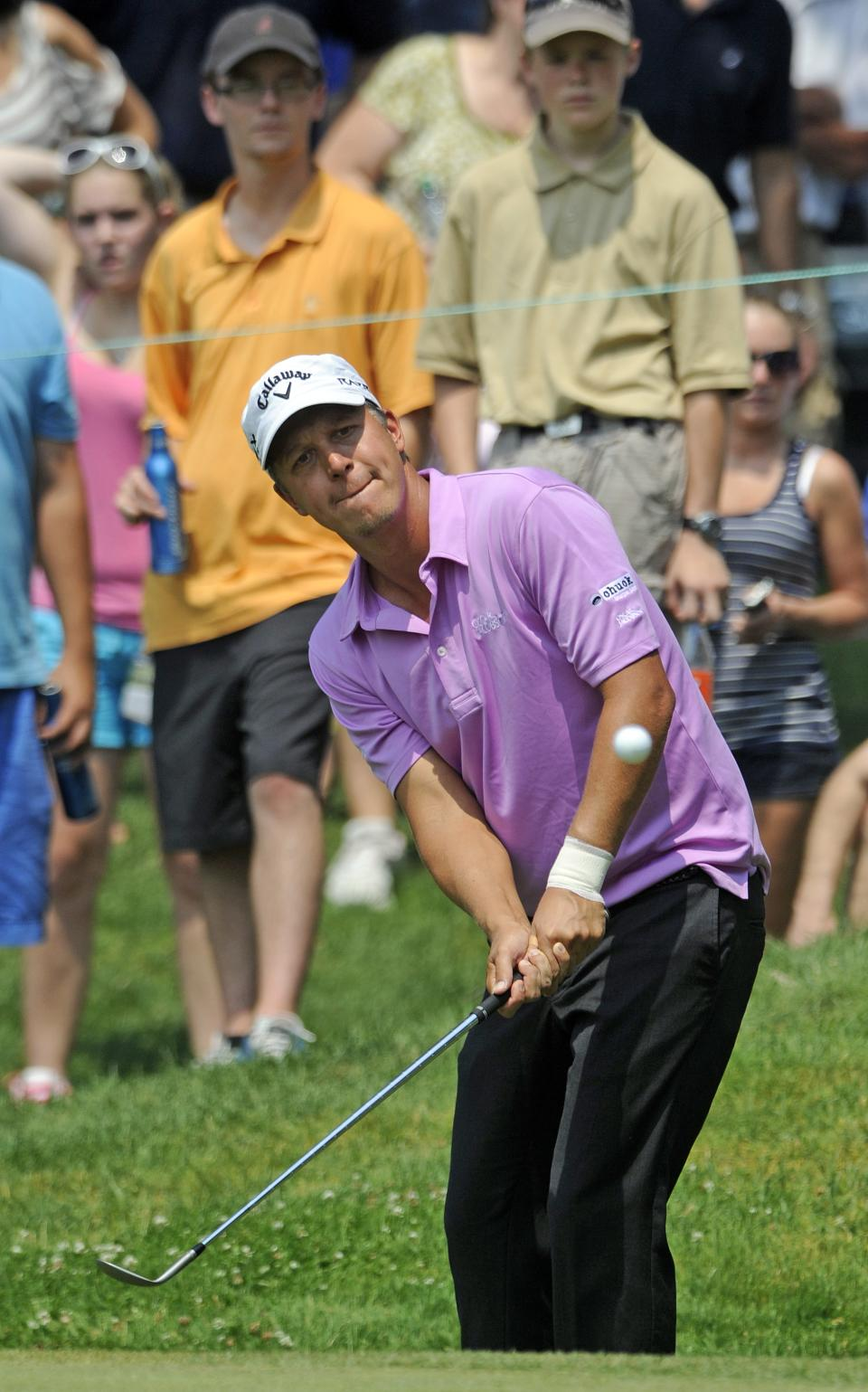 Frederik Jacobsen, of Sweden, chips onto the seventh green during the second round of the Travelers Championship golf tournament in Cromwell, Conn., Friday, June 22, 2012.  (AP Photo/Fred Beckham)