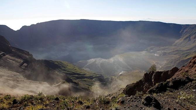 In this photo taken June 22, 2011, sulfuric gases from Mount Tambora's crater seep around its caldera area in West Nusa Tenggara, Indonesia. Bold farmers routinely ignore orders to evacuate the slopes of live volcanoes in Indonesia, but those living on Tambora took no chances when history's deadliest mountain rumbled ominously this month, Sept. 2011. (AP Photo/KOMPAS Images, Fikria Hidayat) EDITORIAL USE ONLY