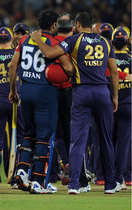 Delhi Daredevils cricketer Irfan Pathan is consoled by brother and Kolkata Knight Riders cricketer Yusuf Pathan after the IPL Twenty20 first playoff cricket match between Delhi Daredevils and Kolkata