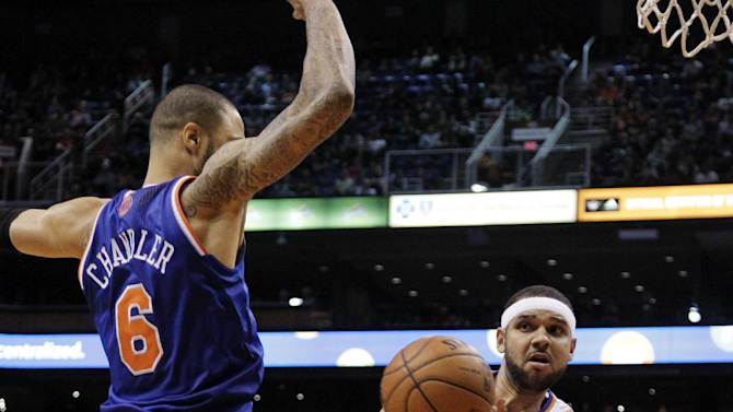 Phoenix Suns' Jared Dudley (3) passes around New York Knicks' Tyson Chandler (6) during the second half of an NBA basketball game, Wednesday, Dec. 26, 2012, in Phoenix. The Knicks won 99-97. (AP Photo/Matt York)
