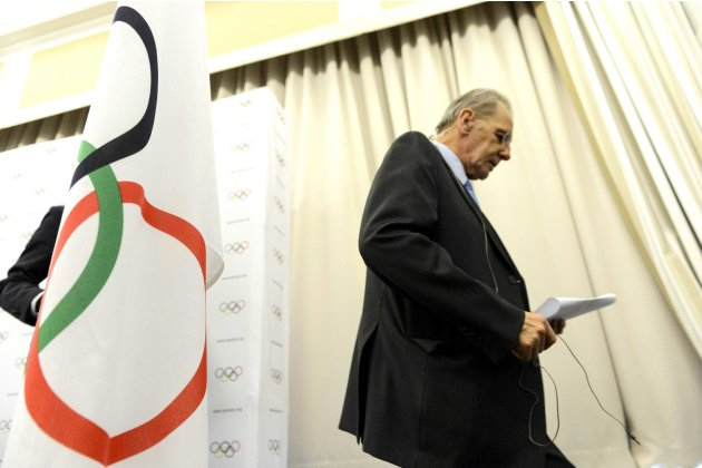 International Olympic Committee, IOC, President Jacques Rogge leaves a press conference after the last day of the executive board's meeting, in Lausanne, Switzerland, Wednesday, Feb. 13, 2013. IOC Pre