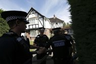 "British police officers arrive at a residential address believed to be the British home of the Hilli family shot dead in their car in the French Alps, in Claygate. Three of the four people killed in a mystery shooting in the French Alps were shot in the head in what the prosecutor in charge of the case Thursday called an act of ""extreme savagery."""