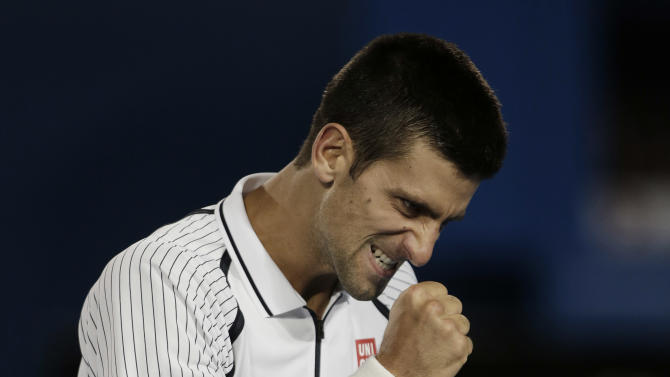 Serbia's Novak Djokovic reacts during his quarterfinal match against Tomas Berdych of the Czech Republic at the Australian Open tennis championship in Melbourne, Australia, Tuesday, Jan. 22, 2013. (AP Photo/Rob Griffith)