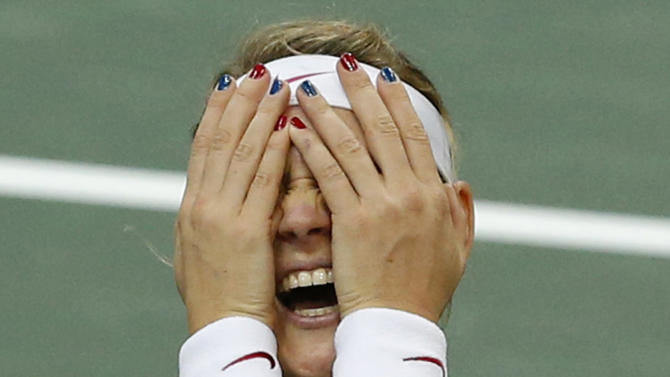 Czech Republic's Lucie Safarova celebrates after winning the Fed Cup  final singles tennis match against Jelena Jankovic from Serbia in Prague, Czech Republic, Sunday, Nov. 4, 2012. Czech Republic won the final by  3-1. (AP Photo/Petr David Josek)