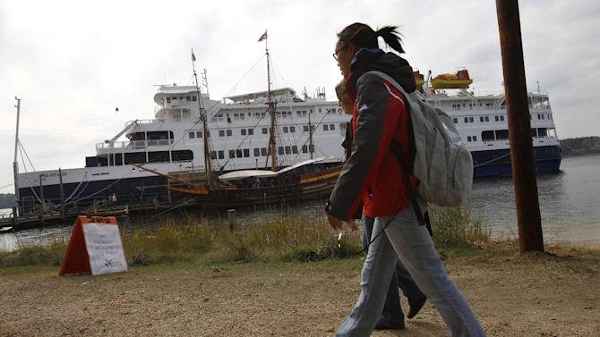 In this photo taken Friday, Nov. 4, 2011, students walk toward the Sea Voyager cruise ship turned dormitory on the St. Mary's River at St. Mary's College, in Lexington Park, Md. The college brought in the cruise ship as a floating dorm after mold made two dormitories unfit to live in. (AP Photo/Jacquelyn Martin)