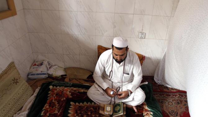 An Afghan Muslim devotee lives and  prays in isolation in a mosque during Itikaf, the last ten days of the Islamic fasting month of Ramadan, in the city of Jalalabad east of Kabul, Afghanistan, Tuesday, Aug. 14, 2012. The last ten days of Ramadan, known as Itikaf, are very important according to many Muslims due to the belief that Prophet Muhammad used to exert himself even more in worship, hoping to draw himself closer to God. Itikaf involves total dedication to worship, reading Quran, and supplication. (AP Photo/Rahmat Gul)