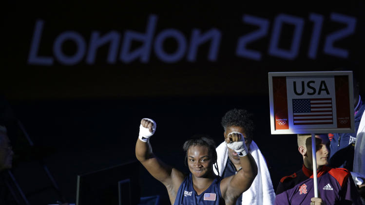 United States' Claressa Shields reacts following a fight against Kazakhstan's Marina Volnova in a women's middleweight 75-kg semifinal boxing match at the 2012 Summer Olympics, Wednesday, Aug. 8, 2012, in London. (AP Photo/Patrick Semansky)