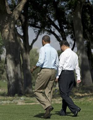 President Barack Obama and Chinese President Xi Jinping, right, walk at the Annenberg Retreat at Sunnylands on Saturday, June 8, 2013, in Rancho Mirage, Calif. Obama and Xi are wrapping up a two-day summit at which they tackled the contentious issue of cybersecurity and tried to forge closer ties between the leaders of the world's largest economies. (AP Photo/Evan Vucci)