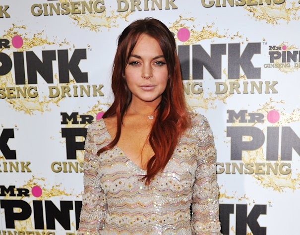 FILE - In this Oct. 11, 2012 file photo, Lindsay Lohan attends the Mr. Pink Ginseng launch party at the Beverly Wilshire hotel in Beverly Hills, Calif. Lohan&#39;s attorney wrote in a letter filed in court on Feb. 22, 2013, that the actress is willing to record public service announcements and provide inspirational talks at schools and hospitals as a possible way to resolve a case that alleges she lied to police about a car accident. (Photo by Richard Shotwell/Invision/AP, File)
