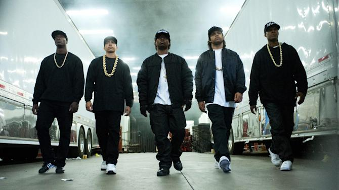 """This photo provided by Universal Pictures shows, Aldis Hodge, from left, as MC Ren, Neil Brown, Jr. as DJ Yella, Jason Mitchell as Eazy-E, O'Shea Jackson, Jr. as Ice Cube and Corey Hawkins as Dr. Dre, in the film, """"Straight Outta Compton.""""  (Jaimie Trueblood/Universal Pictures via AP)"""