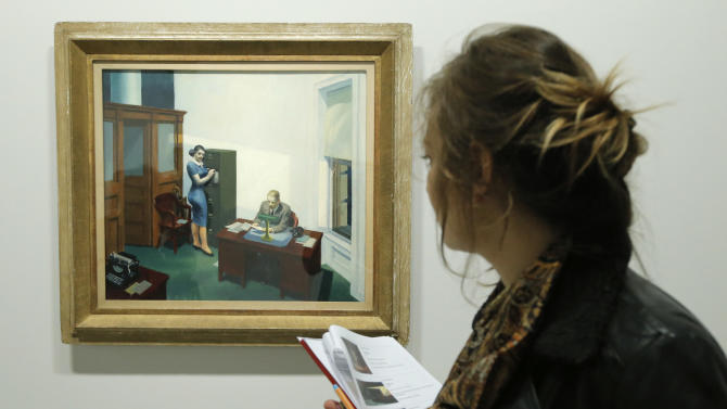 """A woman looks at """"Office at night, 1940"""" as part of the retrospective of Edward Hopper works, one of the great American 20th century artists at Paris' Grand Palais Museum, in Paris, Monday, Oct. 8, 2012. This major Hopper retrospective reveals that the 20th century painter known for his rendering of American life, also drew inspiration from France, and includes some 128 Hopper works, such as the masterpieces """"Nighthawks"""" and """"Soir Bleu"""".(AP Photo/Francois Mori)"""