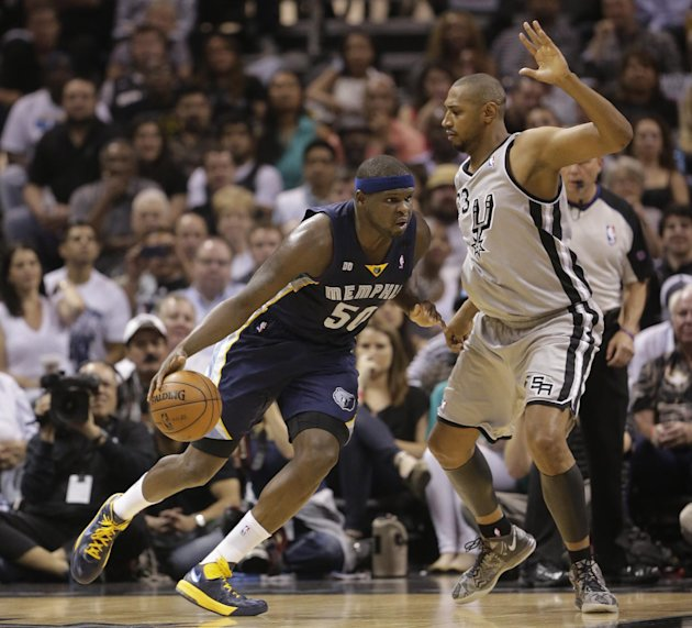 Memphis Grizzlies' Zach Randolph (50) drives the ball against San Antonio Spurs' Boris Diaw (33), of France, during the first half in Game 2 of the Western Conference finals NBA basketball playoff ser