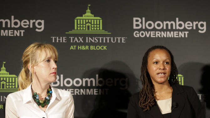 IMAGE DISTRIBUTED FOR THE TAX INSTITUTE AT H&R BLOCK - Ms. Laura Minzer, Executive Director of the Health Care Council at the Illinois Chamber of Commerce, left, listens as Illinois Deputy Governor for Public Policy Cristal Thomas speaks during an event on the tax implications of health care reform in Springfield, Ill., Wednesday, April 10, 2013. The event is part of a multi-city engagement tour hosted by The Tax Institute at H&R Block and Bloomberg Government examining the effects of the Affordable Care Act on consumers, small businesses and the uninsured.  (AJ Mast / AP Images for The Tax Institute at H&R Block)