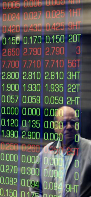 A man watches news on display boards at the Australian Stock market in Sydney, Australia, Thursday, Aug. 11, 2011. Asian markets headed sharply lower early Thursday over mounting concerns about the health of Europe's banks and France's debt rating. (AP Photo/Rick Rycroft)