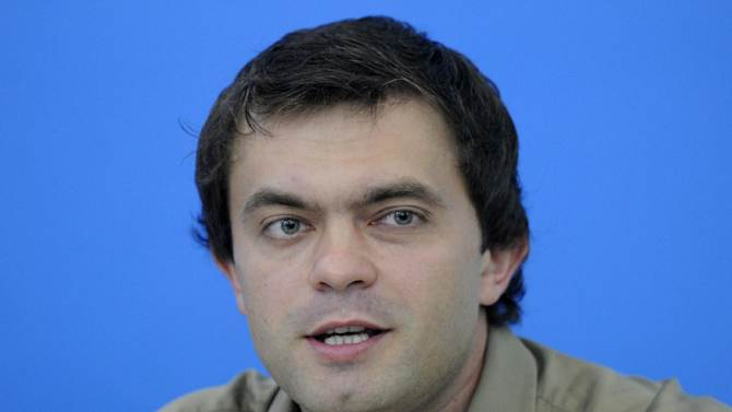 "Ruslan Kukharchuk, a journalist who heads the movement ""Love against homosexuality"" talks to reporters in Kiev, Ukraine, Monday, July 23, 2012. Kukharchuk supports a bill that would ban the ""propaganda of homosexuality"" . (AP Photo/Sergei Chuzavkov)"