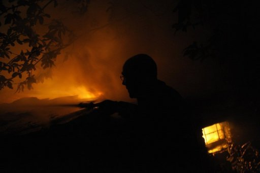 <p>A Spanish firefighter tries to extinguish a fire burning near the village of Millarouso, in northwestern Spain. Hundreds of hectares are again in flames in Spain's Canary Islands and mainland Galicia region as a pitiless heatwave shows no signs of letting up.</p>
