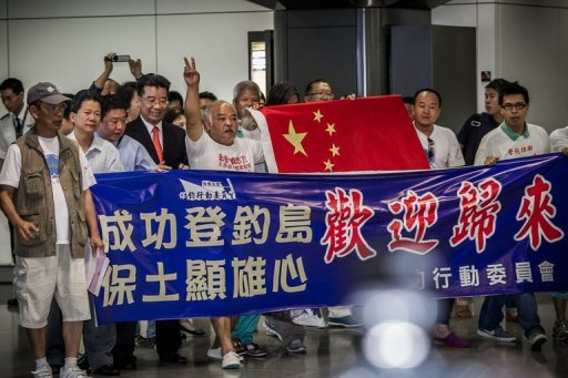 "<p>Chinese activists arrive at the airport in Hong Kong on August 17 following their deportation from Japan, after they sailed to a disputed island. China on Saturday demanded that Japan immediately cease actions ""harming"" its territorial sovereignty amid the escalating dispute over rival claims to islands in the East China Sea.</p>"