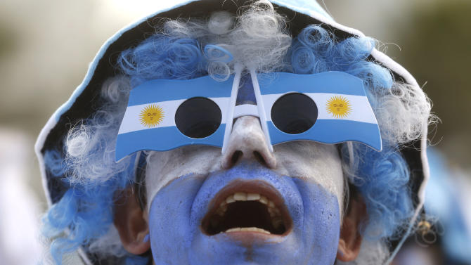 An Argentina soccer fan watches his team's World Cup match with Iran at a live telecast inside the FIFA Fan Fest area on Copacabana beach, in Rio de Janeiro, Brazil, Saturday, June 21, 2014. Argentina won 1-0. (AP Photo/Silvia Izquierdo)