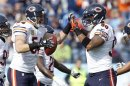 Bears line backer Urlacher celebrates with defensive end Peppers after recovering a fumble in the first half of their NFL football game against the Titans in Nashville
