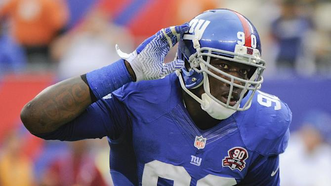New York Giants defensive end Jason Pierre-Paul (90) reacts after a defensive play against the Houston Texans in the second quarter of an NFL football game, Sunday, Sept. 21, 2014, in East Rutherford, N.J