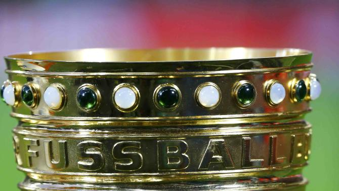 German soccer Cup trophy is displayed prior to semi-final between Bayern Munich and Borussia Dortmund in Munich