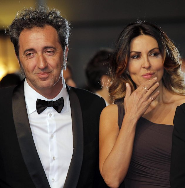 Director Paolo Sorrentino, left, and actress Sabrina Ferilli arrive for the screening of The Great Beauty at the 66th international film festival, in Cannes, southern France, Tuesday, May 21, 2013. (A