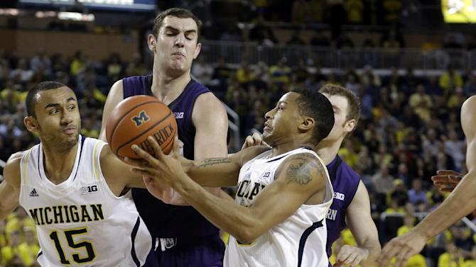 Michigan guard Trey Burke (3) drives to the basket during the second half of an NCAA college basketball game against Northwestern in Ann Arbor, Mich., Wednesday, Jan. 30, 2013. (AP Photo/Carlos Osorio)