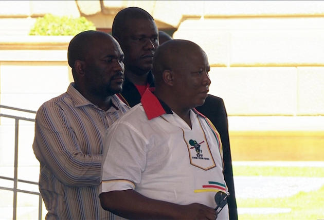 Still image from SABC video shows Julius Malema standing beside the coffin of former South African President Nelson Mandela at the Union Buildings in Pretoria