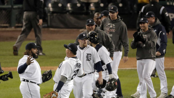 Detroit Tigers' Prince Fielder, left, and Miguel Cabrera celebrate after Game 3 of the American League championship series against the New York Yankees Tuesday, Oct. 16, 2012, in Detroit. The Tigers won 2-1. (AP Photo/Charlie Riedel)