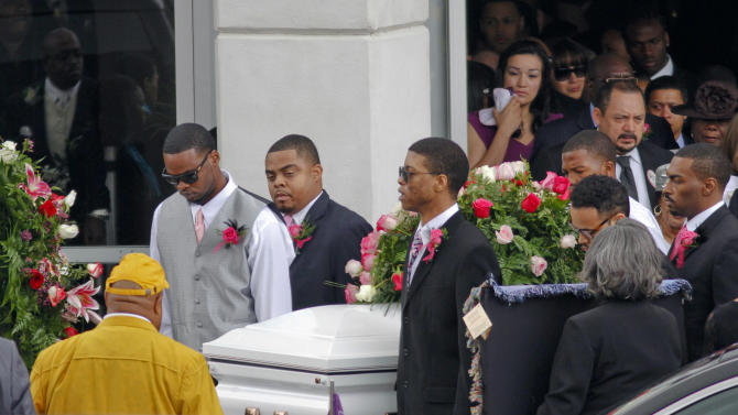 Pallbearers carry the casket of Kasandra Perkins following her funeral service at the St. James Missionary Baptist Church on Saturday, Dec. 8, 2012, in Austin, Texas. Perkins was shot and killed last Saturday by her boyfriend, Kansas City Chiefs football player Jovan Belcher, before he proceeded to kill himself. (AP Photo/Jack Plunkett)