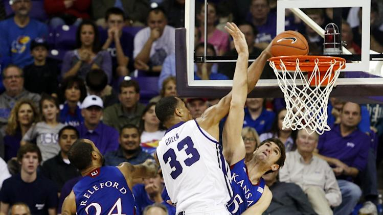 TCU forward Garlon Green (33) dunks as Kansas guards Travis Releford (24) and Elijah Johnson (15) and center Jeff Withey (5) defend during the second half of an NCAA college basketball game, Wednesday, Feb. 6, 2013, in Fort Worth, Texas. TCU won 62-55. (AP Photo/Sharon Ellman)